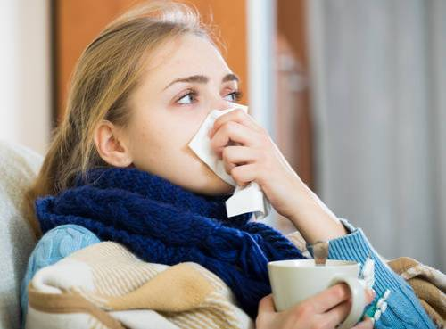 Portrait of girl suffering of cold and having stuffy nose